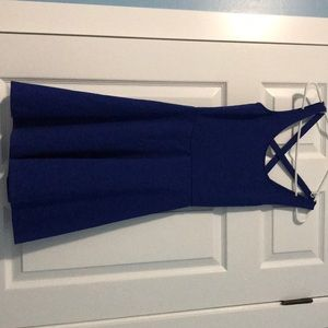 Blue short dress with an x on the back